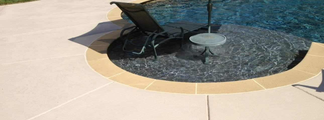 Decorative concrete texture overlay for knock down and non slip pool deck coating