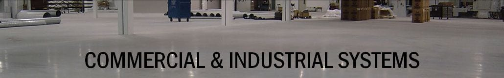 Commercial Industrial Concrete Floor Coating System showing grey epoxy floor coating for an industrial factory. Heavy duty forklift traffic floor coating to withstand industrial loads. High chemical resistant floors. Seamless factory epoxy floor coating that looks like concrete paint but provides extreme chemical resistance.