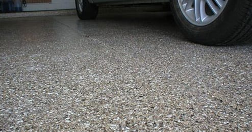 Florochip Commercial Industrial Epoxy Flake Floor Coating System in a commercial automotive service garage. Epoxy flake floors provide excellent slip fall protection due to their high traction. Multi colored vinyl flakes, which are also known as chips, are broadcast into colored epoxy floor coatings then finished with a grout coat of industrial clear epoxy and finished with chemical resistant urethane for a long service life.