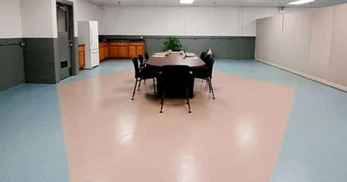 Floroquartz High Impact Colored Quartz Epoxy Floor Coating System shown as the floor coating for a commercial break room floor. Epoxy quartz floor coating systems provide extreme abrasion resistance in commercial floor coating applications. High impact resistance is gained with the addition of colored quartz aggregate in thick epoxy floor coatings. The chemical resistant urethane floor finish protects the industrial floor for a long service life.